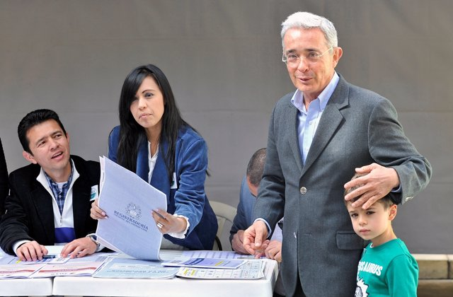 Colombian former President Alvaro Uribe casts his vote during the legislative el