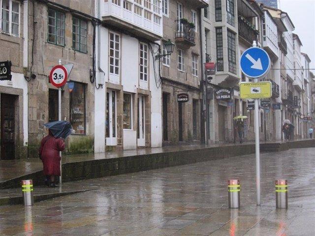 Temporal en Santiago, choiva, temporal, paraugas, vento