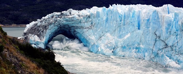 Pieces of ice fall from the front of Argentina's Perito Moreno glacier near the