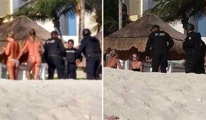 Policías mexicanos abandonan un operativo para hacerse fotos con turistas en topless