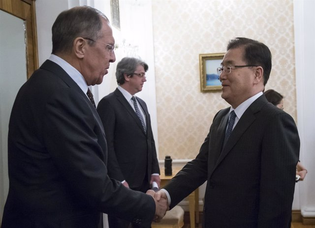 Russia's Foreign Minister Sergei Lavrov (L) shakes hands with South Korea's Nati