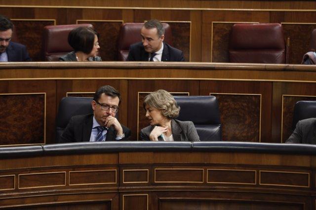 Román Escolano e Isabel García Tejerina en el pleno del Congreso sobre pensiones