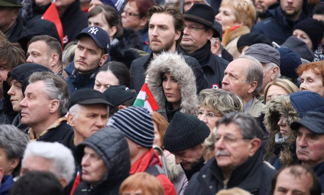 People listen as Hungary's Prime Minister Viktor Orban speaks during Hungary's N