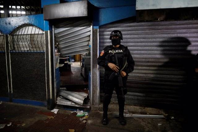 A policeman secure a seized MS-13 gang related store during the Operation Cuscat