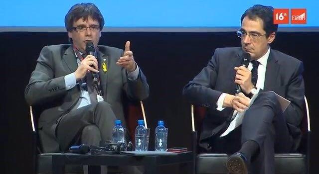 L'expresident de la Generalitat  Carles Puigdemont en un debat en Ginebra