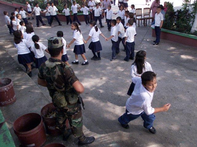 A Honduran soldier stands guard in the Lila Luz de Maradiaga elementary School