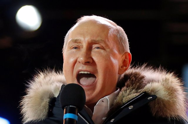 Russian President and Presidential candidate Vladimir Putin delivers a speech du