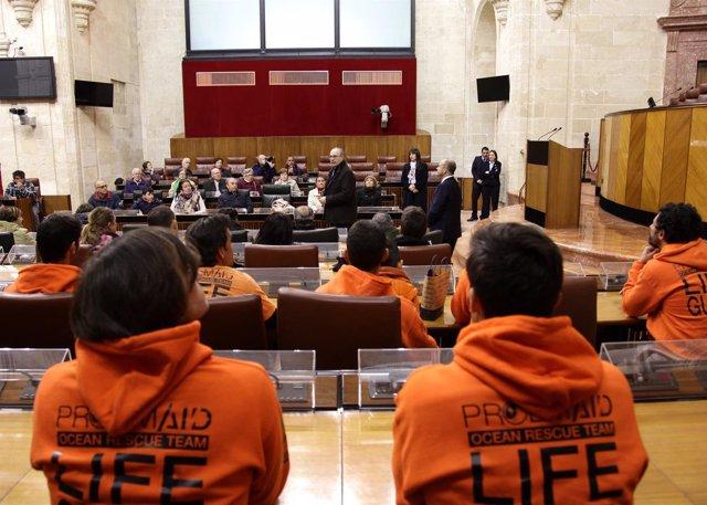 Bomberos de Proem-AID, en el Pleno del Parlamento andaluz