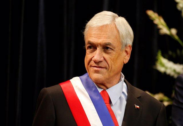 Chile's President Sebastian Pinera waits to receive protocol greetings at La Mon