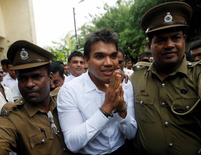 FILE PHOTO: Namal Rajapaksa (C), son of former Sri Lanka's President Mahinda Raj