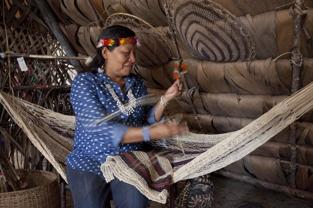 Ecuador's Waorani Indian leader Manuela Omare Ima shows how to use a native arro