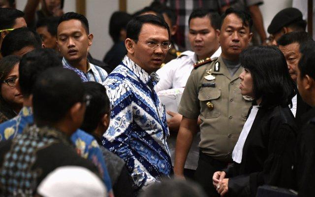 FILE PHOTO: Jakarta's Christian governor Basuki Tjahaja Purnama (L), popularly k