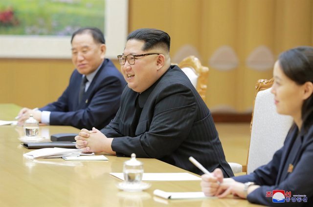 FILE PHOTO: North Korean leader Kim Jong Un meets members of the special delegat