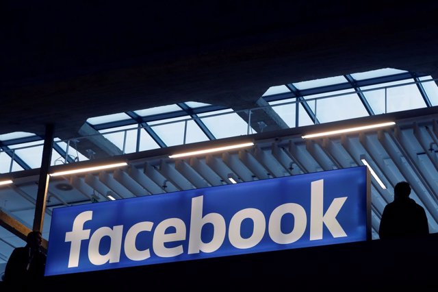 Facebook logo is seen  at a start-up companies gathering at Paris' S