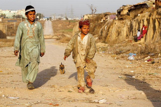 Children arrive to play with friends at an Afghan refugee camp in Islamabad, Pak