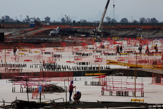 Employees work on the terminals foundations at the construction site of the new