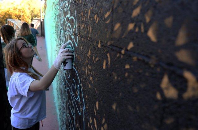 Grafiti grafitero adolescentes taller D. Darko