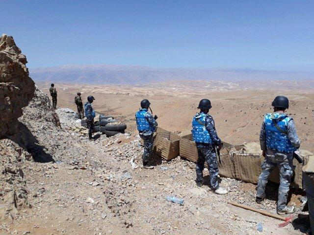 Militares del Ejército sirio y milicianos de Hezbolá en las montañas de Qalamun