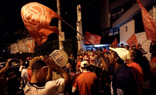 Supporters of former Brazil president Luiz Inacio Lula da Silva shout slogans in