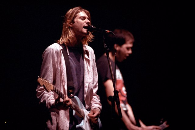 Nirvana frontman Kurt Cobain performing on stage at Le Zenith in Paris, France