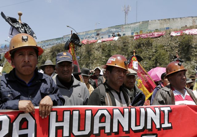 Mine workers attend a rally demanding the extradition of former Bolivian Preside