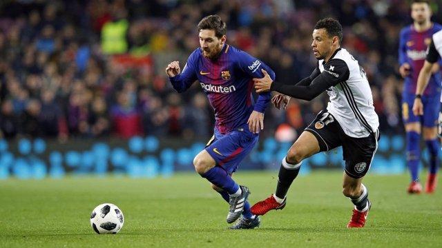 Messi (Barcelona) y Coquelin (Valencia)