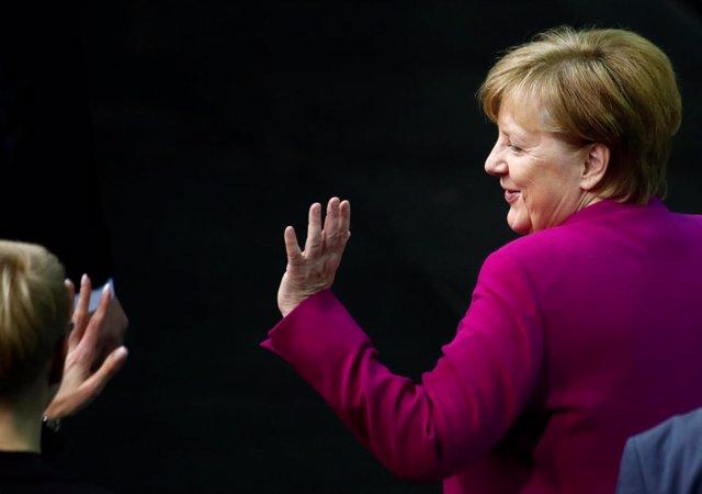 Foto de archivo de Angela Merkel tras firmar el acuerdo de coalición en marzo