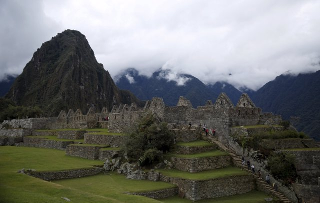 Visitors walk at the Inca citadel of Machu Picchu in Cusco, Peru, August 12, 201