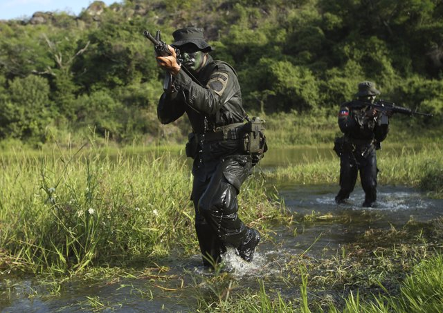 Policemen take part in training during the Jungla International Course, in Chico