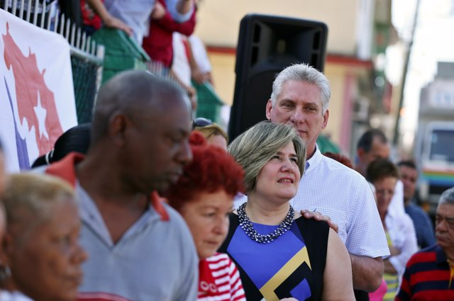 Cuba's First Vice-President Miguel Diaz-Canel stands in line with his wife Lis C