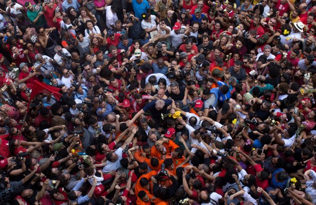 Former Brazilian President Luiz Inacio Lula da Silva is carried by supporters in