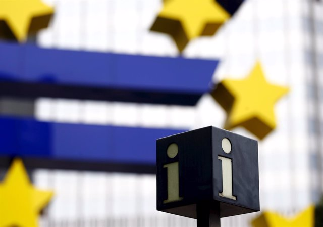 A tourist information sign is seen next to the euro sign landmark outside the fo