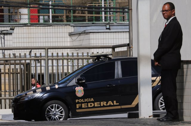 A Federal Police car is seen next to the headquarter of the Brazilian Olympic Co