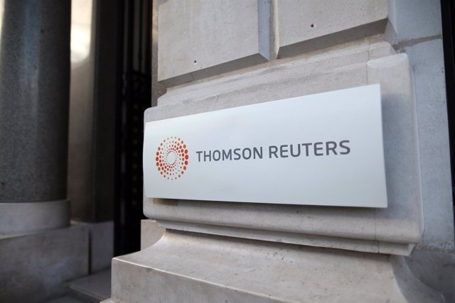 FILE PHOTO: The logo of Thomson Reuters is pictured at the entrance of its Paris