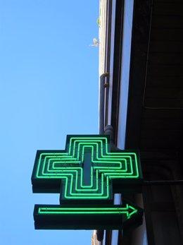 Señal informativa de una farmacia