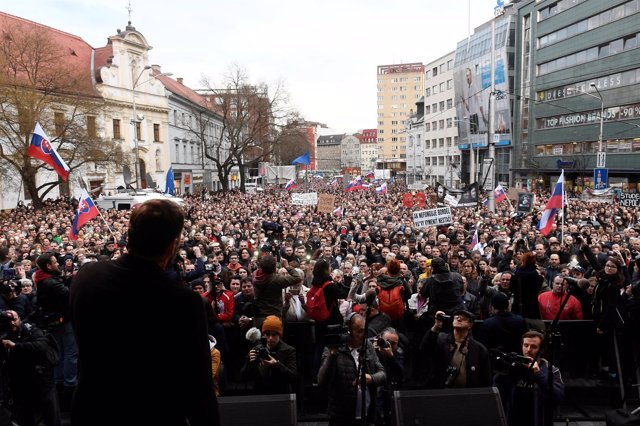 People attend a protest rally in reaction to the murder of Slovak investigative