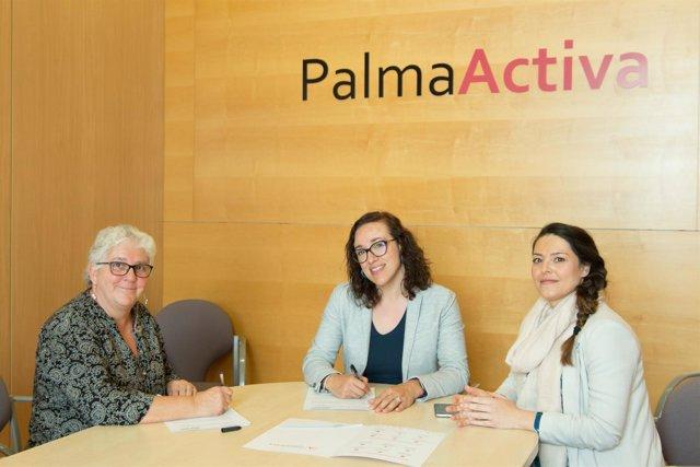 Firma del convenio entre PalmaActiva y REAS Baleares