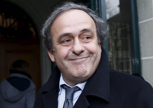 UEFA President Michel Platini smiles as he arrives for a hearing at the Court of