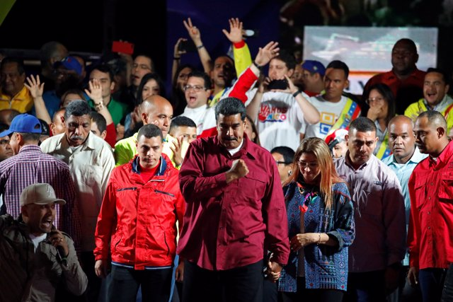 Venezuela's President Nicolas Maduro stands with supporters during a gathering a