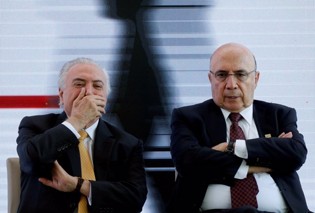 Brazil's President Michel Temer (L) reacts next to presidential candidate for th
