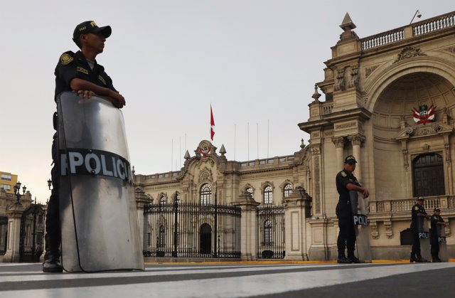 Peruvian police guard in front of the Government Palace after Peru's President P