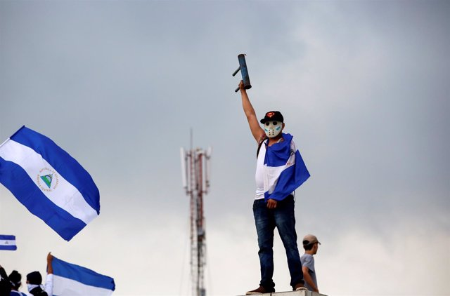 A demonstrator takes part in a protest march against Nicaraguan President Daniel