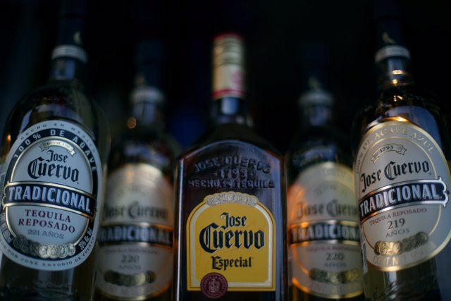 Bottles of Jose Cuervo Tequila rest on a shelf in Mexico City, Mexico, February