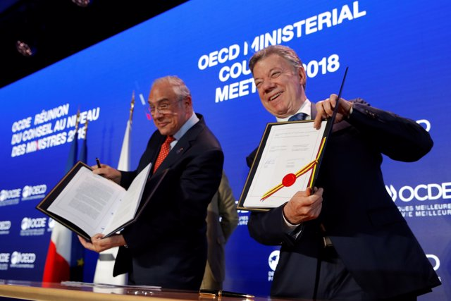 Colombia's president Juan Manuel Santos and Organisation for Economic Co-operati