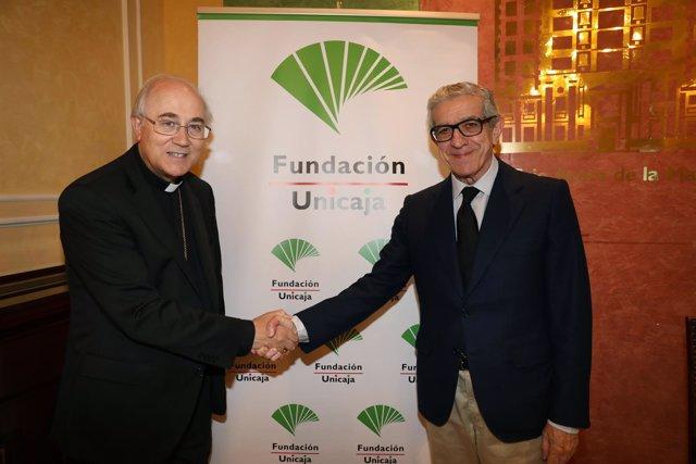 González Montes y Braulio Medel tras la firma del convenio