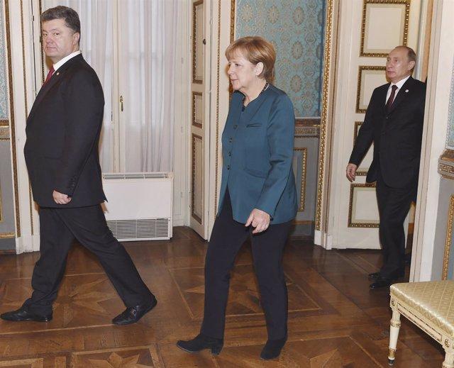 Poroshenko, Merkel y Putin, en una imagen de archivo