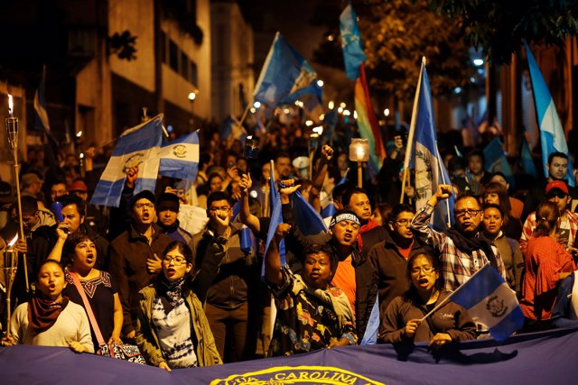 Demonstrators take part in a protest against the Guatemalan government's disaste