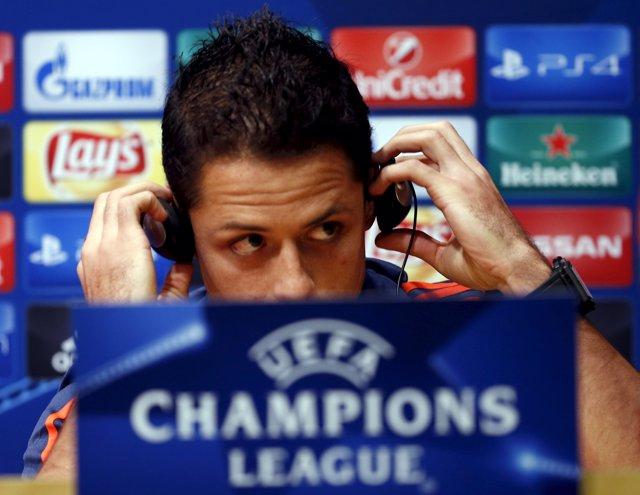 """Bayer Leverkusen's Javier """"Chicharito"""" Hernandez adjusts his earphones during a"""