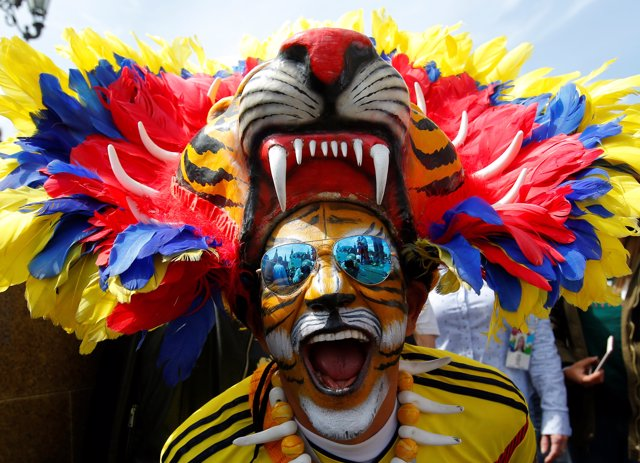A supporter of the Colombian national soccer team cheers during a gathering on t