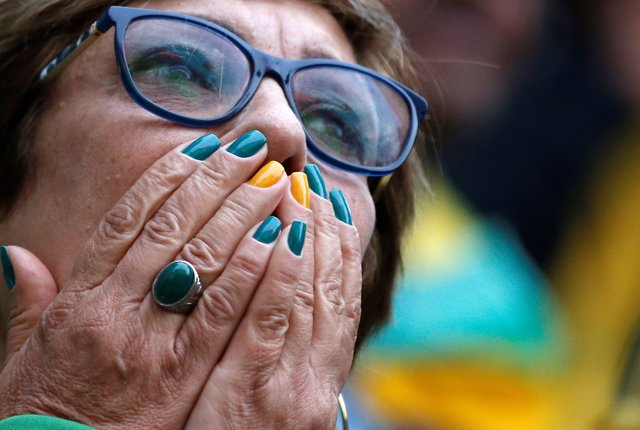 A fan reacts as she watches the broadcast of the FIFA World Cup Group E soccer m